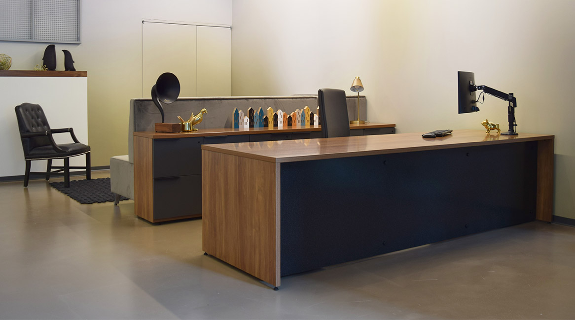 WaveWorks desk and storage unit modified in width and modified to have Corian modesty panel insert.