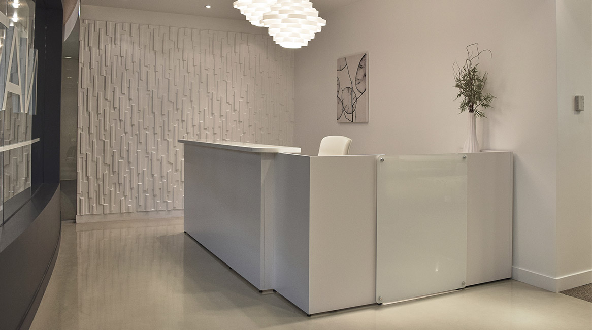 WaveWorks reception station modified to have Corian transaction counter and back painted glass accent panel.